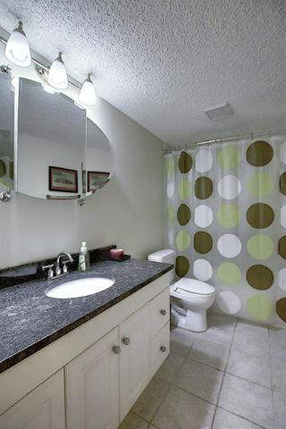 Photo 29: 165 Lakeside Greens Place: Chestermere Semi Detached for sale : MLS®# A1028449