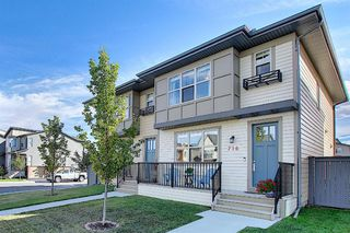 Photo 2: 716 WALDEN Drive SE in Calgary: Walden Duplex for sale : MLS®# A1031671