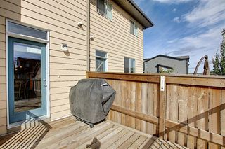 Photo 15: 716 WALDEN Drive SE in Calgary: Walden Duplex for sale : MLS®# A1031671