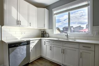 Photo 13: 716 WALDEN Drive SE in Calgary: Walden Duplex for sale : MLS®# A1031671