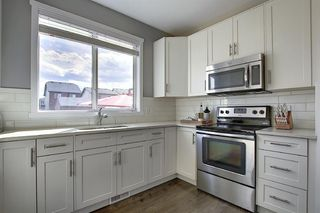 Photo 11: 716 WALDEN Drive SE in Calgary: Walden Duplex for sale : MLS®# A1031671