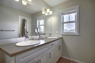Photo 21: 716 WALDEN Drive SE in Calgary: Walden Duplex for sale : MLS®# A1031671