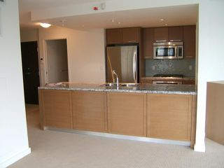 """Photo 2: 1707 918 COOPERAGE Way in Vancouver: False Creek North Condo for sale in """"MARINER"""" (Vancouver West)  : MLS®# V792475"""