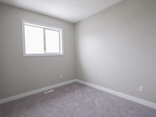 Photo 12: 55 Rivercrest Circle SE in Calgary: Riverbend Detached for sale : MLS®# A1044132