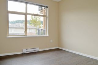 """Photo 10: 309 500 KLAHANIE Drive in Port Moody: Port Moody Centre Condo for sale in """"THE TIDES"""" : MLS®# R2521595"""