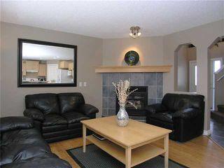 Photo 5: 90 New Brighton Circle SE in CALGARY: New Brighton Residential Detached Single Family for sale (Calgary)  : MLS®# C3420247