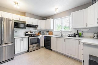 """Photo 1: 208 19953 55A Avenue in Langley: Langley City Condo for sale in """"Bayside Court"""" : MLS®# R2461204"""
