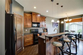 Photo 8: 417 Cimarron Boulevard: Okotoks Detached for sale : MLS®# C4301022