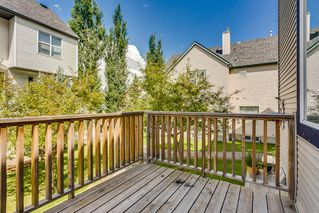 Photo 5: 206 BRIDLEWOOD Lane SW in Calgary: Bridlewood Row/Townhouse for sale : MLS®# A1015543