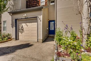 Photo 2: 206 BRIDLEWOOD Lane SW in Calgary: Bridlewood Row/Townhouse for sale : MLS®# A1015543