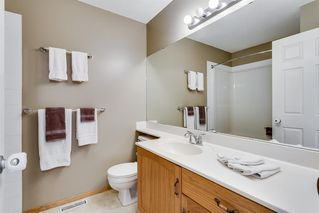 Photo 15: 206 BRIDLEWOOD Lane SW in Calgary: Bridlewood Row/Townhouse for sale : MLS®# A1015543