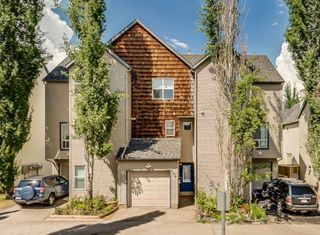 Photo 1: 206 BRIDLEWOOD Lane SW in Calgary: Bridlewood Row/Townhouse for sale : MLS®# A1015543