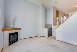 Photo 6: 206 BRIDLEWOOD Lane SW in Calgary: Bridlewood Row/Townhouse for sale : MLS®# A1015543