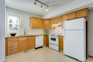 Photo 10: 206 BRIDLEWOOD Lane SW in Calgary: Bridlewood Row/Townhouse for sale : MLS®# A1015543