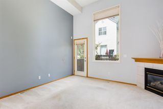 Photo 4: 206 BRIDLEWOOD Lane SW in Calgary: Bridlewood Row/Townhouse for sale : MLS®# A1015543
