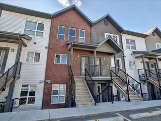 Photo 1: 59 2560 Pegasus Boulevard in Edmonton: Zone 27 Townhouse for sale : MLS®# E4213738