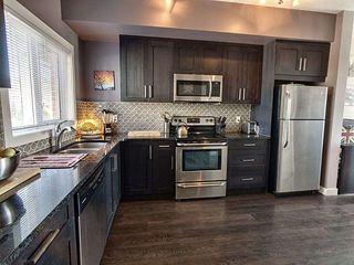 Photo 3: 59 2560 Pegasus Boulevard in Edmonton: Zone 27 Townhouse for sale : MLS®# E4213738