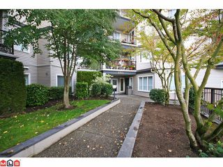 "Photo 1: 215 5765 GLOVER Road in Langley: Langley City Condo for sale in ""COLLEGE COURT"" : MLS®# F1013966"