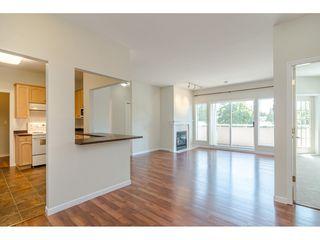 "Photo 1: 209 21975 49 Avenue in Langley: Murrayville Condo for sale in ""Trillium"" : MLS®# R2390189"
