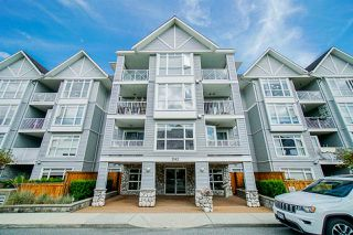 "Photo 1: 310 3142 ST JOHNS Street in Port Moody: Port Moody Centre Condo for sale in ""Sonrisa"" : MLS®# R2469785"