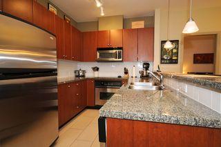 "Photo 11: 204 100 CAPILANO Road in Port Moody: Port Moody Centre Condo for sale in ""SUTER BROOK"" : MLS®# V807432"