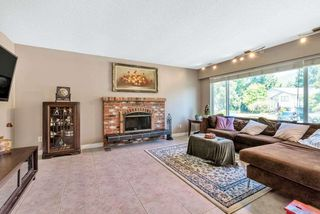 Photo 2: 3911 VICTORIA Place in Port Coquitlam: Oxford Heights House for sale : MLS®# R2396765