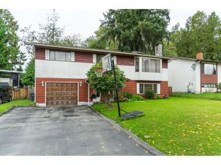 Photo 2: 9159 APPLEHILL Crescent in Surrey: Queen Mary Park Surrey House for sale : MLS®# R2407744