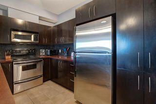 Photo 7: 230 69 SPRINGBOROUGH Court SW in Calgary: Springbank Hill Apartment for sale : MLS®# A1037353