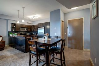 Photo 3: 230 69 SPRINGBOROUGH Court SW in Calgary: Springbank Hill Apartment for sale : MLS®# A1037353