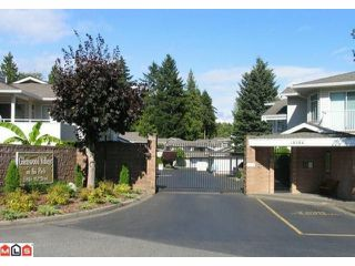 "Photo 1: 204 10584 153RD Street in Surrey: Guildford Townhouse for sale in ""Glenwood Village on the Park"" (North Surrey)  : MLS®# F1019376"
