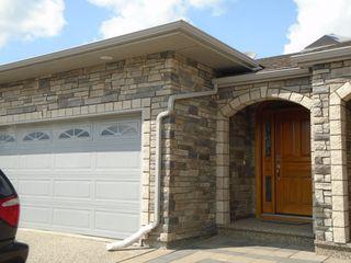 Photo 1: 10500 103 Avenue in Morinville: Condo for rent