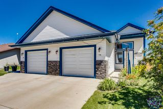 Photo 1: 738 Carriage Lane Drive: Carstairs Duplex for sale : MLS®# A1019396