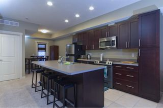 Photo 4: 24 WEST SPRINGS Lane SW in Calgary: West Springs Row/Townhouse for sale : MLS®# A1050646