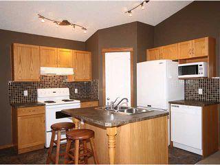Photo 4: 125 TARACOVE Way NE in CALGARY: Taradale Residential Detached Single Family for sale (Calgary)  : MLS®# C3456094