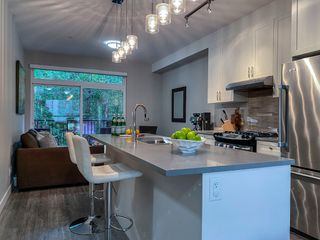 """Photo 2: 1177 NATURES GATE Crescent in Squamish: Downtown SQ Townhouse for sale in """"Natures Gate at Eaglewind"""" : MLS®# R2459208"""