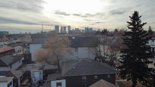 Photo 2:  in Calgary: Tuxedo Park Row/Townhouse for sale : MLS®# A1055723