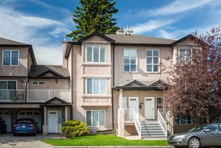 Photo 1:  in Calgary: Tuxedo Park Row/Townhouse for sale : MLS®# A1055723
