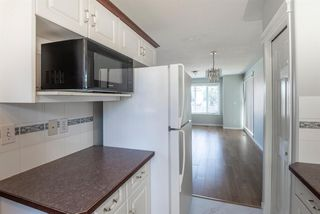 Photo 11:  in Calgary: Tuxedo Park Row/Townhouse for sale : MLS®# A1055723