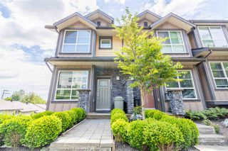 "Photo 1: 101 1418 CARTIER Avenue in Coquitlam: Maillardville Townhouse for sale in ""CARTIER PLACE"" : MLS®# R2477824"