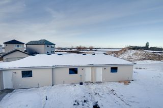 Photo 33: 158 Dansereau Way in Beaumont: Attached Home for sale