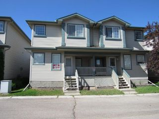 Photo 1: 44, 14803 Miller Boulevard in Edmonton: House Half Duplex for rent