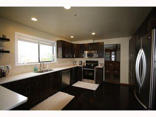 """Photo 3: 6404 CHARING Court in Burnaby: Buckingham Heights House for sale in """"Buckingham Heights"""" (Burnaby South)  : MLS®# V814427"""