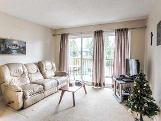 "Photo 1: 206 5191 203 Street in Langley: Langley City Townhouse for sale in ""Longlea"" : MLS®# R2422119"