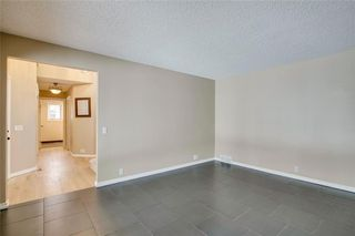 Photo 8: 61 Suncastle Crescent, Sundance Calgary Realtor Steven Hill SOLD Luxury Home