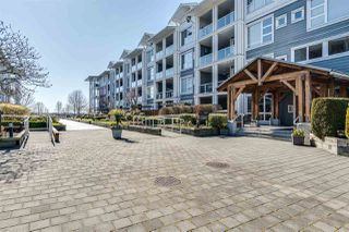 "Photo 1: 112 4500 WESTWATER Drive in Richmond: Steveston South Condo for sale in ""COPPER SKY WEST"" : MLS®# R2443316"
