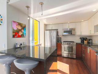 "Photo 9: 404 1485 W 6TH Avenue in Vancouver: False Creek Condo for sale in ""Carrara of Portico"" (Vancouver West)  : MLS®# R2408477"