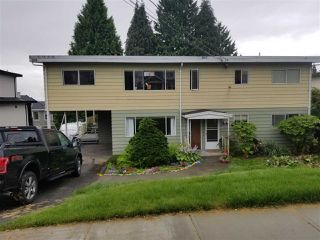 Photo 1: 1048 - 1050 MADORE Avenue in Coquitlam: Central Coquitlam Duplex for sale : MLS®# R2478531