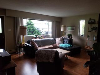 Photo 2: 1048 - 1050 MADORE Avenue in Coquitlam: Central Coquitlam Duplex for sale : MLS®# R2478531