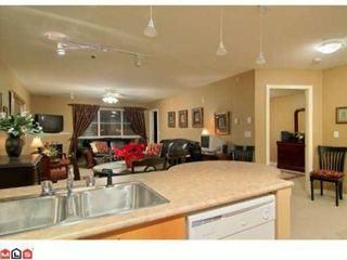 """Photo 2: 506 12083 92A Avenue in Surrey: Queen Mary Park Surrey Condo for sale in """"THE TAMARON"""" : MLS®# F1004479"""