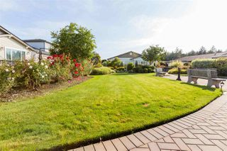 "Photo 19: 105 19639 MEADOW GARDENS Way in Pitt Meadows: North Meadows PI House for sale in ""DORADO"" : MLS®# R2398961"